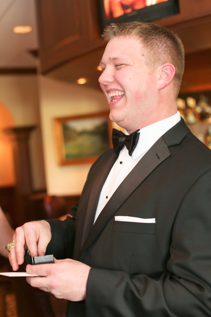 Opening his awesome cufflinks